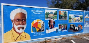 Rufus Pinkney Mural located in the spot where he used to operate his shoe shine stand.