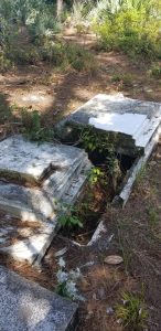 Damaged headstone at Oaklynn Cemetery in Volusia County, FL